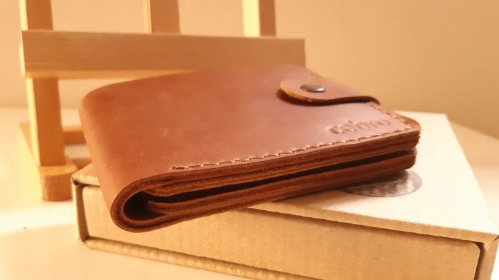 Universal brown leather wallet with clasp and coin compartment